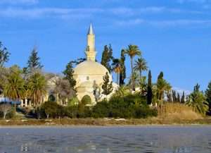 Hala Sultan Tekke is surrounded by a grove of cypress and palm trees along with the Larnaca salt lake.